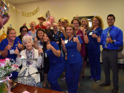 Evelyn surrounded by the NorthBay clinical team and her family members, all giving thumbs up to the camera.