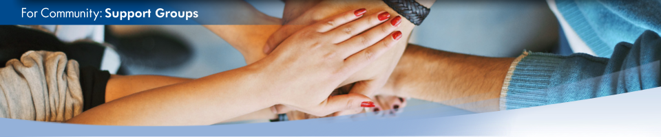 A group of people place their hands on top of each other as a sign of teamwork. This is the home page for Support Groups.