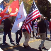 Hospice volunteers marching in a parade that celebrated veterans.