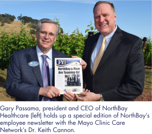 Gary Passama, president and CEO of NorthBay Healthcare (left) holds up a special edition of NorthBay's employee newsletter with the Mayo Clinic Care Network's Dr. Keith Cannon.
