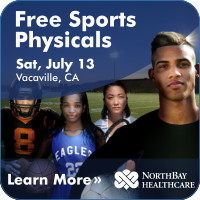 Group of high school athletes from various sports on a field, looking out at the viewer. Click here to learn more about the free sports physicals on July 13.