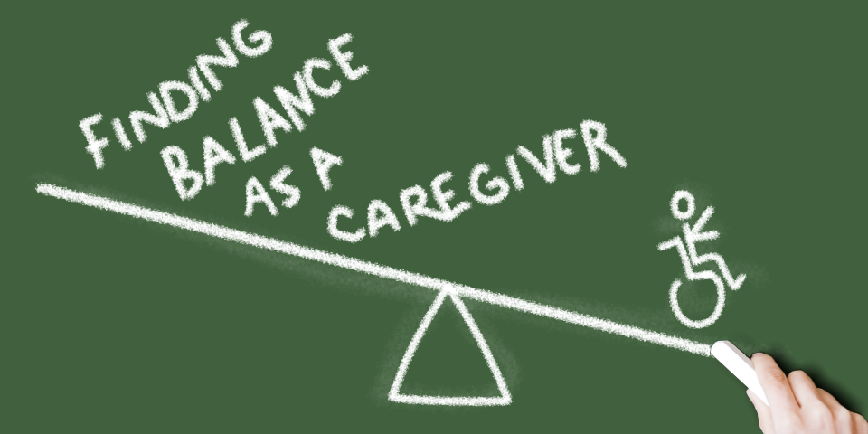A chalkboard drawing on a scale on a green board. On the left hand of the scale is the text 'Finding Balance As A Caregiver', a drawing of a person in a wheelchair is on the right of the scales.