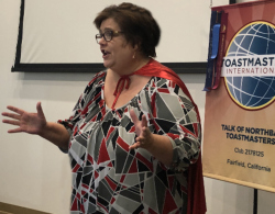 Social Media/Online Specialist Robin Miller speaks during the Toastmasters Open House.