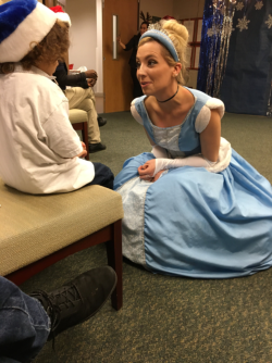 Marcelo Emerson, who donated his birthday presents for the Center for Women's Health party chats with Cinderella.