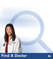 "A doctor stand in front of a blue magnifying glass on a white background. The text ""Find a Doctor"" in white font appears on a blue bar under the image. Click here to be taken to our physician search."
